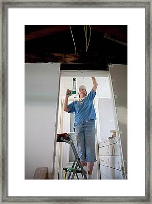Repairing Flood Damage Framed Print by Jim West