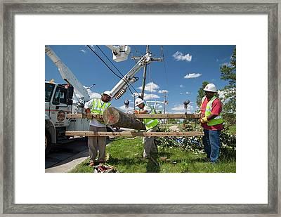 Repairing Power Lines Framed Print