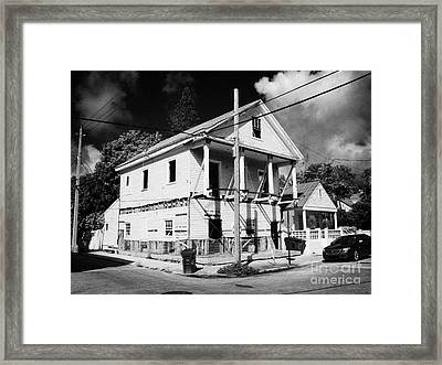 Repairs To Traditional Two Storey Wooden House In The Old Town Of Key West Florida Usa Framed Print by Joe Fox