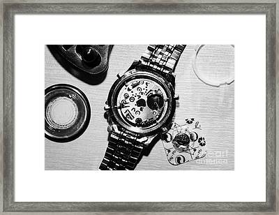 Replacing The Battery In A Metal Band Wrist Watch Framed Print by Joe Fox