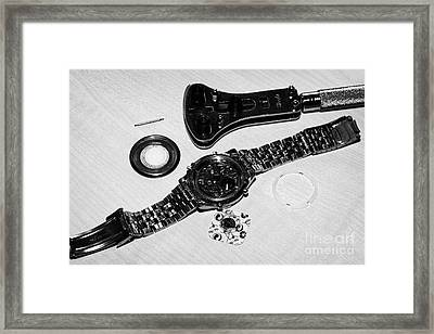 Replacing The Battery In A Metal Band Wristwatch Framed Print by Joe Fox