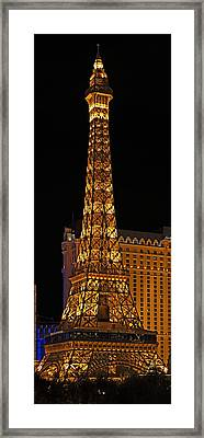 Replica Of The Eiffel Tower Lit Framed Print by Panoramic Images