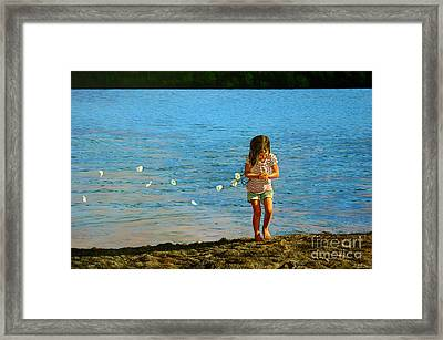 Rescuer Framed Print by Christopher Shellhammer