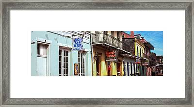 Restaurants Along Bourbon Street Framed Print by Panoramic Images