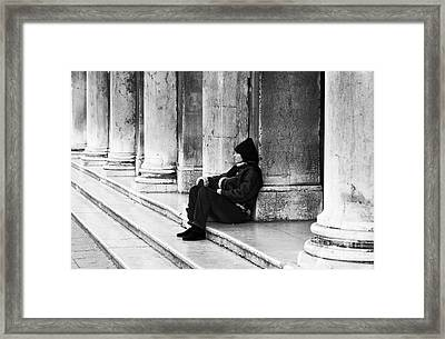 Resting At St. Mark's Square Framed Print by John Rizzuto