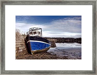 Retired Boat Framed Print by Olivier Le Queinec
