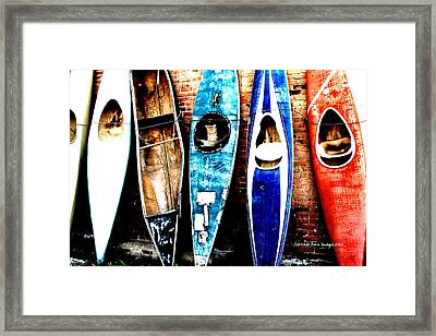 retired Kayaks Framed Print by Rebecca Adams
