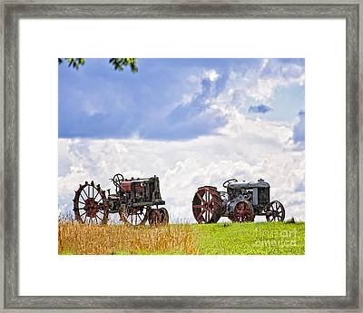 Retired Tractors Framed Print by Timothy Flanigan