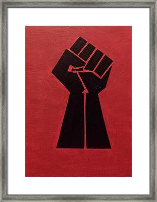Revolutionist Fist  Framed Print by Donald Beasley