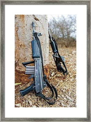 Rhino Security Patrol Guns Framed Print by Peter Chadwick