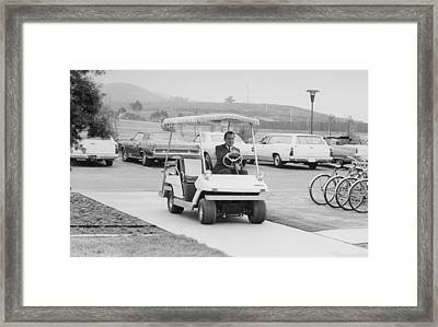 Richard Nixon Driving A Golf Cart Framed Print by Everett