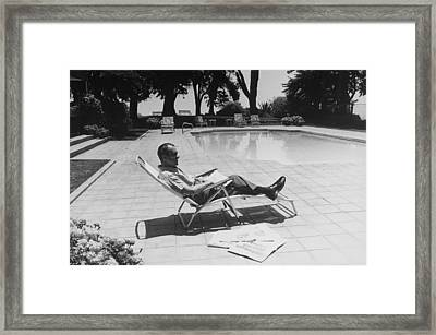 Richard Nixon Reading Newspapers While Framed Print by Everett