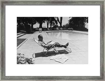 Richard Nixon Reading Newspapers While Framed Print