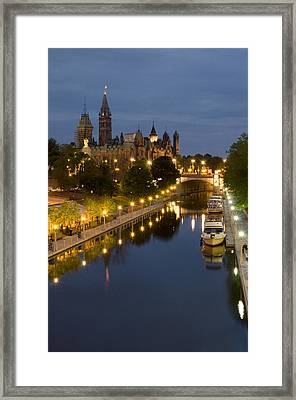 Rideau Canal And The Parliament Buildings At Night Framed Print by Rob Huntley