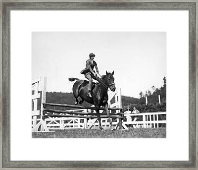 Rider Jumps At Horse Show Framed Print by Underwood Archives