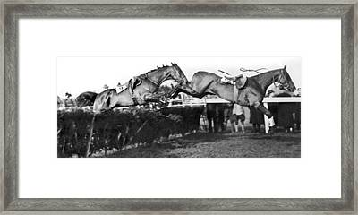 Riderless Horses Take Jump Framed Print by Underwood Archives