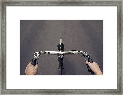 Riding A Bicycle  Framed Print by Julien Balmer