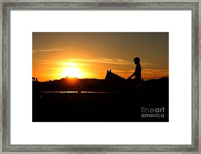 Riding At Sunset Framed Print