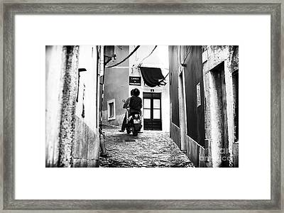 Riding In Alfama Framed Print by John Rizzuto