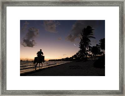 Riding On The Beach Framed Print by Adam Romanowicz