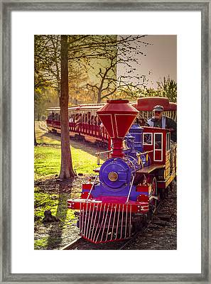 Riding Out Of The Sunset On The Hermann Park Train Framed Print