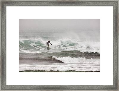Riding The Waves In A Snow Storm Framed Print by Tim Grams