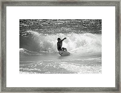 Riding The Waves Framed Print by Thomas Fouch