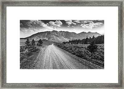 Riding To The Mountains Framed Print