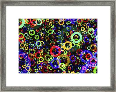 Rings In Space Framed Print by Daniel Hagerman