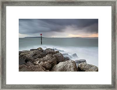 Ringstead Bay Framed Print by Chris Frost