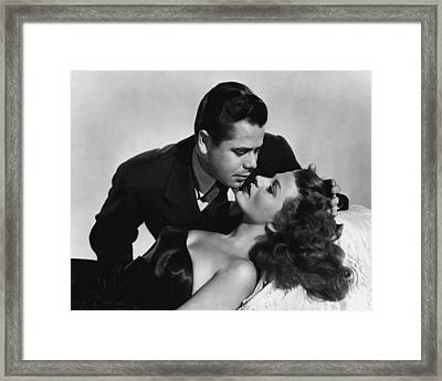 Rita Hayworth About To Be Kissed Framed Print