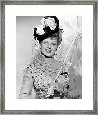 Rita Hayworth Under Umbrella Framed Print by Retro Images Archive