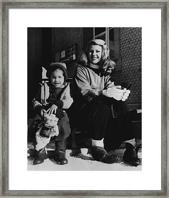 Rita Hayworth With Girl Framed Print by Retro Images Archive