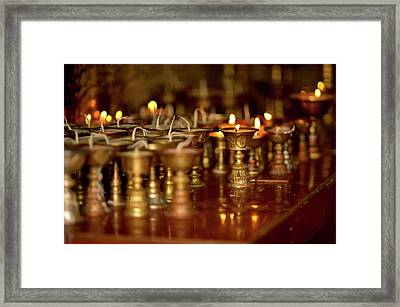 Ritual Lamps In A Buddhist Monastery Framed Print by Jaina Mishra