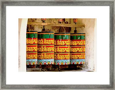 Ritual Prayer Wheels At A Buddhist Framed Print