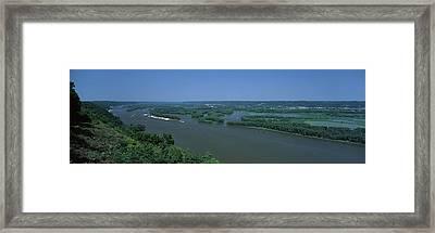 River Flowing Through A Landscape Framed Print