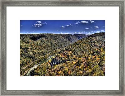 River Running Through A Valley Framed Print by Jonny D