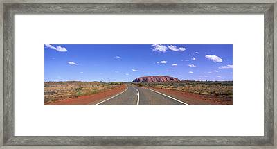 Road And Ayers Rock Australia Framed Print by Panoramic Images