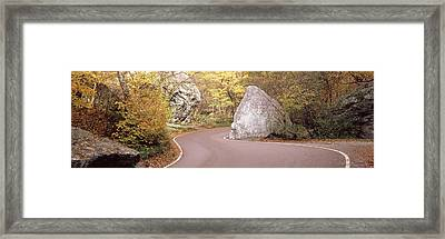 Road Curving Around A Big Boulder Framed Print by Panoramic Images
