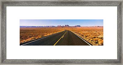 Road Passing Through A Desert, Monument Framed Print by Panoramic Images