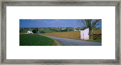 Road Passing Through A Field, Amish Framed Print
