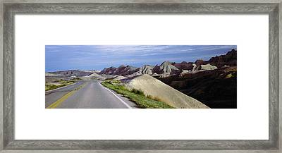 Road Passing Through The Badlands Framed Print