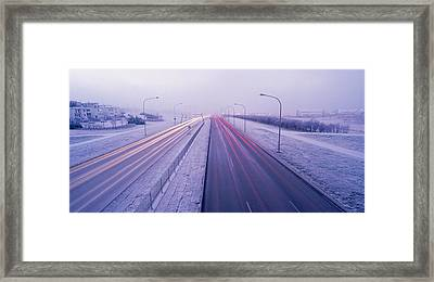 Road Running Through A Snow Covered Framed Print by Panoramic Images