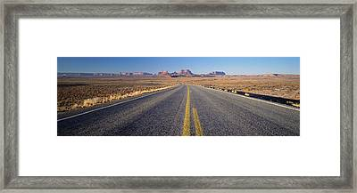 Road Through Monument Valley, Utah Framed Print by Panoramic Images