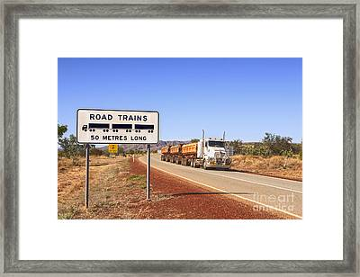 Road Train Warning Sign And Roadtrain Just Passing By Framed Print