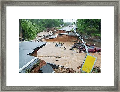 Road Washed Out By Flooding Framed Print by Jim Edds