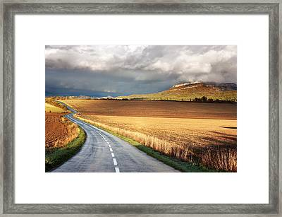 Road With Stormy Clouds Framed Print by Mikel Martinez de Osaba