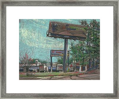 Roadside Billboards Framed Print