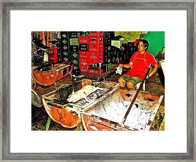 Roasting A Suckling Pig Streetside In Saigon-vietnam  Framed Print by Ruth Hager