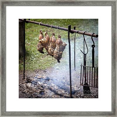 Roasting String Chickens On Open Fire Framed Print by John Stephens